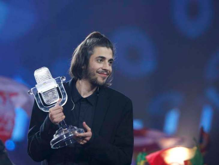 Portugal's Salvador Sobral celebrates after winning the grand final of the Eurovision Song Contest 2017 at the International Exhibition Centre in Kiev